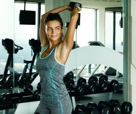 woman holding a dumbbell in the gym Stock Photo 07