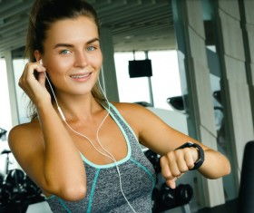 woman listening to music in the gym Stock Photo