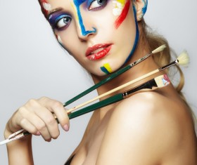 woman with a paint on her face and a brush HD picture 02