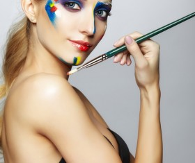 woman with a paint on her face and a brush HD picture 03