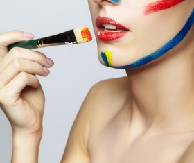 woman with a paint on her face and a brush HD picture 04
