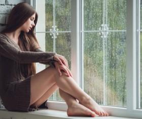 Beautiful girl on the windowsill HD picture