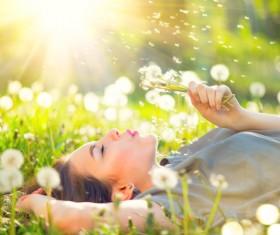 Blowing dandelion woman Stock Photo