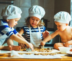 Children making cookies in the kitchen Stock Photo