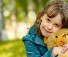 Cute little girl holding a teddy bear Stock Photo
