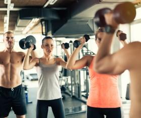 Dumbbell fitness men and women Stock Photo 01