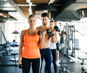 Dumbbell fitness men and women Stock Photo 02