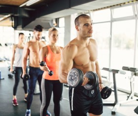 Dumbbell fitness men and women Stock Photo 04