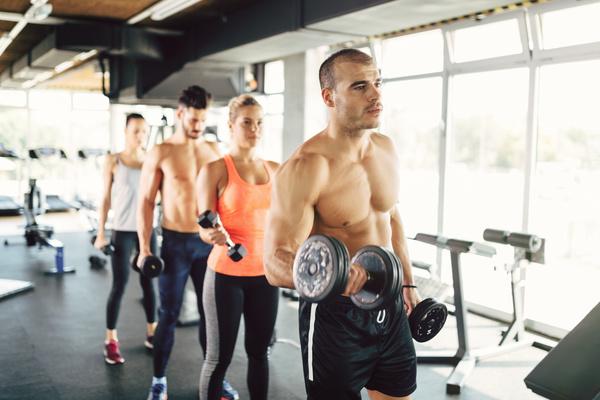 Dumbbell fitness men and women Stock Photo 04