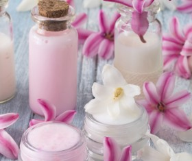 Essential oils and petals on the desktop Stock Photo 02