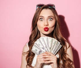 Eyes wide open woman holding the dollar Stock Photo