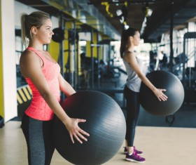 Girl holding a fitness ball Stock Photo