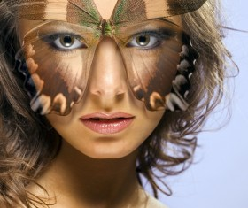 Girl with butterfly mask Stock Photo