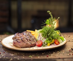Grilled steak with garnish HD picture