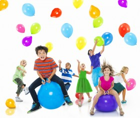 Happy children with balloons Stock Photo