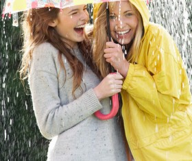 Happy friends in the rain Stock Photo