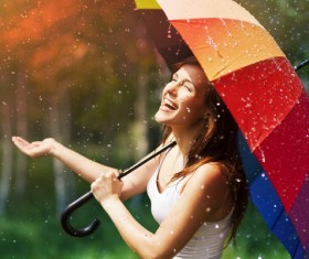 Happy woman in the rain Stock Photo