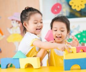 Kindergarten children building blocks Stock Photo