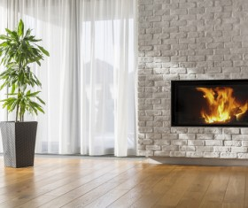Living room fireplace with large plants Stock Photo