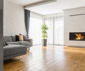 Living room with fireplace and corner sofa Stock Photo