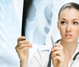 Look at the X-ray female doctor Stock Photo