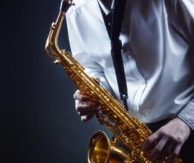 Man blowing saxophone Stock Photo