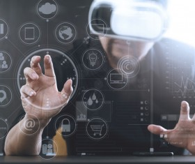 Men with VR glasses touch the virtual screen Stock Photo 02