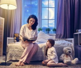 Mother reading to children HD picture