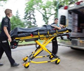 Push the patient on the ambulance Stock Photo