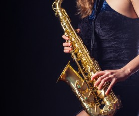 Saxophone playing woman Stock Photo
