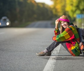 Sitting on the roadside rest of the woman Stock Photo