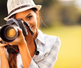 Smiling female photographer Stock Photo