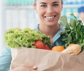 Smiling lady to buy food Stock Photo