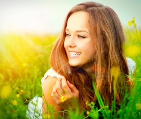 Smiling woman in the grass HD picture