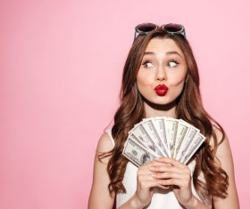 Strabismus woman holding dollars Stock Photo