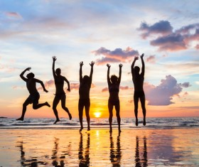 Sunset seaside happy people jumping HD picture