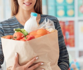 Supermarket ladies with food Stock Photo