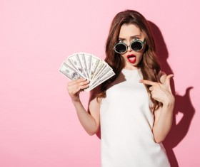 Surprised woman holding the dollar Stock Photo