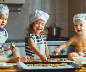 The children who make the biscuits Stock Photo