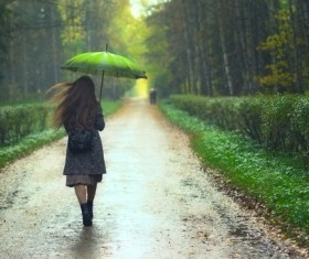 The girl walking in the forest path Stock Photo