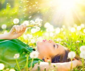 The sun blowing dandelion woman Stock Photo