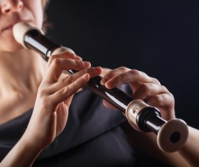 The woman who blows the flute Stock Photo