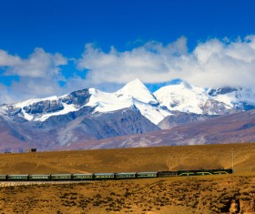 Tibet train and snow-capped mountains HD picture