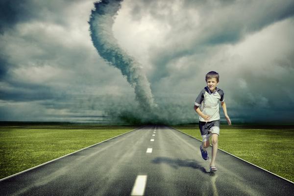 Tornado and boy Stock Photo