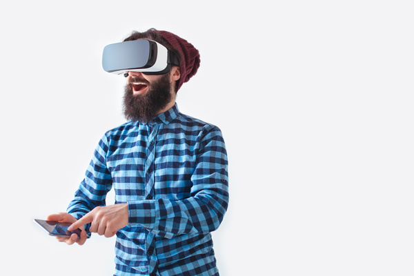 Man with VR headset and smartphone