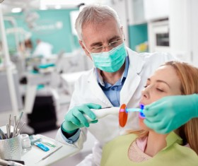 dentist who treats the patient Stock Photo