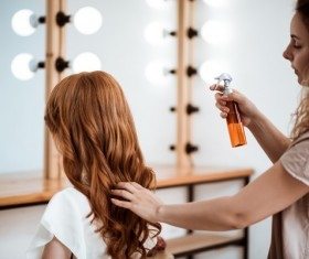 hairdresser who takes care of the hair for the customer Stock Photo 01