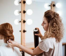 hairdresser who takes care of the hair for the customer Stock Photo 02