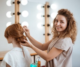 hairdresser who takes care of the hair for the customer Stock Photo 03
