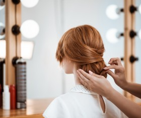 hairdresser who takes care of the hair for the customer Stock Photo 04